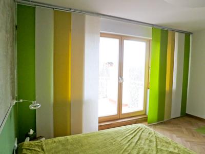 zasłony panelowe w sypialni
